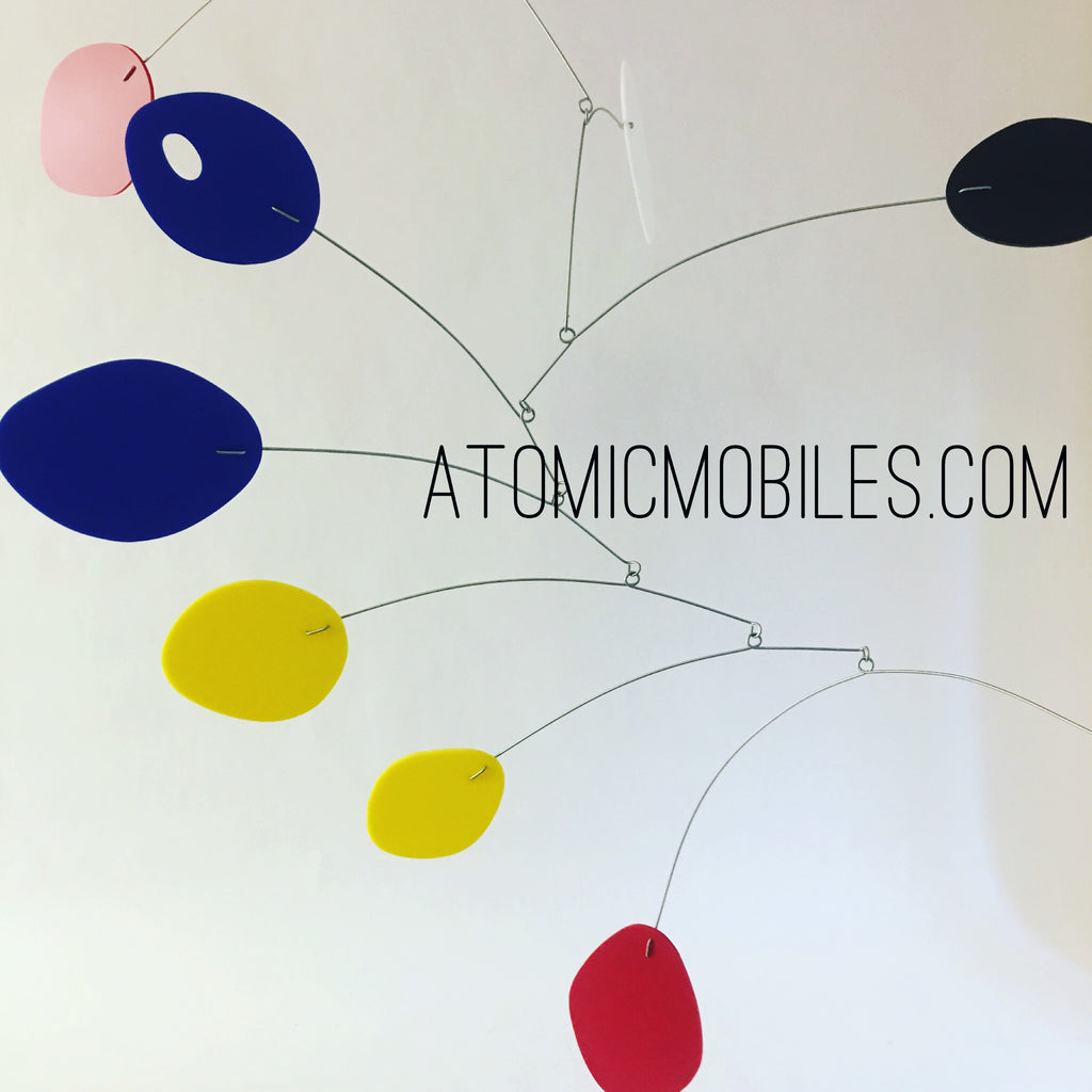 Blue yellow and red large hanging art mobile for client in NC by AtomicMobiles.com