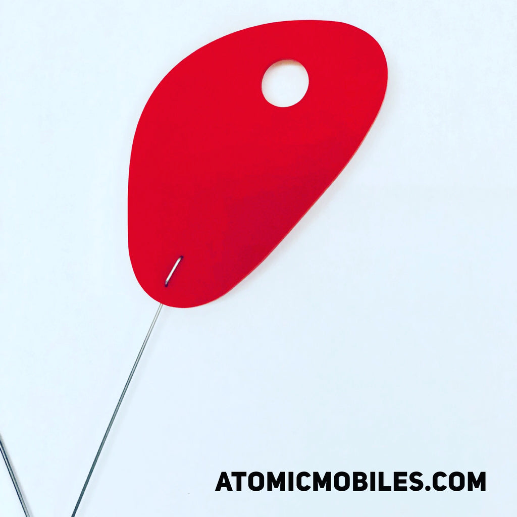 Closeup of red modern hanging art mobile created for Benjamin Moore by AtomicMobiles.com