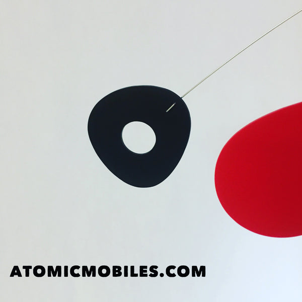 Close up of black and red custom hanging mobile for client in France by AtomicMobiles.com