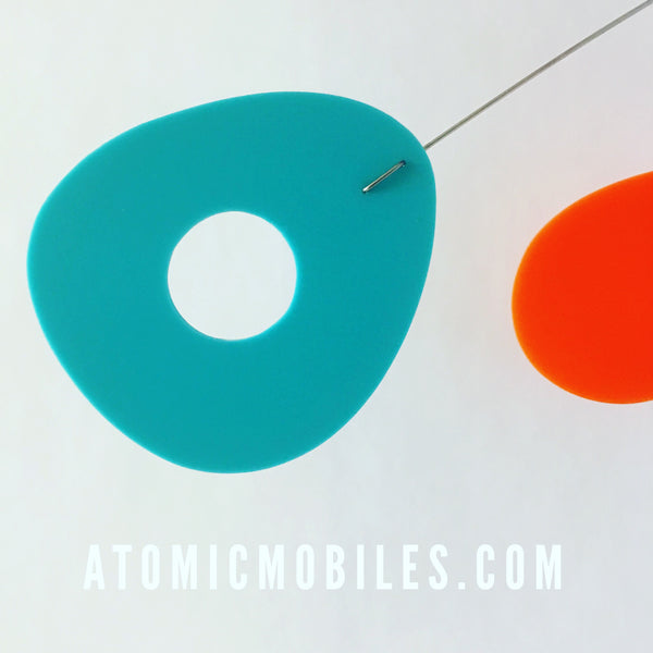Closeup of ModCast hanging art mobile by AtomicMobiles.com in Aqua, Orange, and Lime