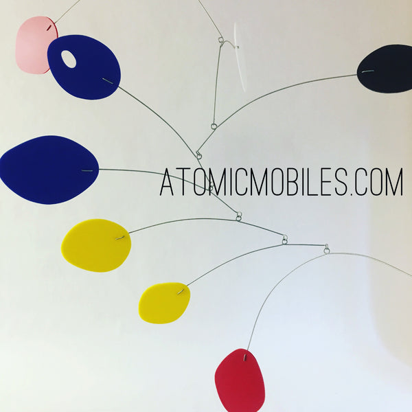 Blue yellow and red hanging art mobile in size Large for client in NC by AtomicMobiles.com