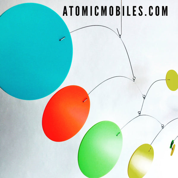 MOD Mobile in Palm Springs colors of aqua blue, orange, lime green, and yellow by AtomicMobiles.com