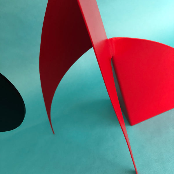 The Moderne Art Stabile by AtomicMobiles.com in red and black