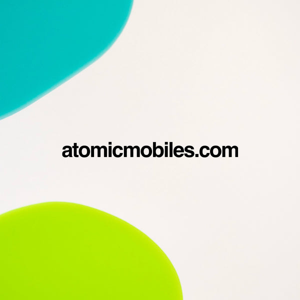 Closeup of JetSet Modern Art Mobile in Aqua and Lime by AtomicMobiles.com