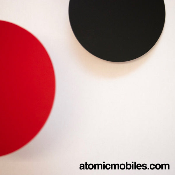 Closeup of red and black parts of MOD Mobile by AtomicMobiles.com - retro style hanging art mobile