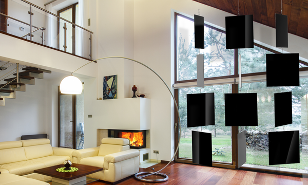 XXL MODcast Luxury Art Mobiles hanging in modern contemporary room with vaulted ceiling, fireplace, leather couch, and long curved lamp - mobiles by AtomicMobiles.com