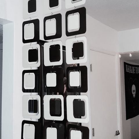 Black and White Coolsville Room Divider installed in mid century modern home by AtomicMobiles.com