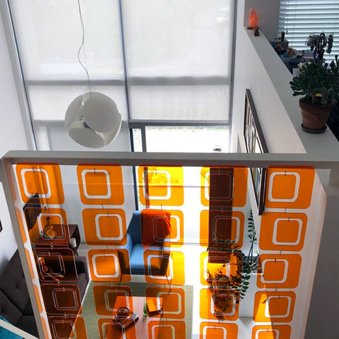 Clear Orange Coolsville Room Divider installed in stairway railing in mid century modern home by AtomicMobiles.com