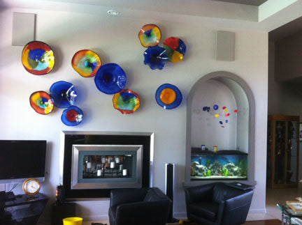 Client photo of Atomic Mobile hanging over fish aquarium