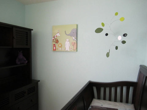 Hanging mobile by AtomicMobiles.com - client photo in baby nursery