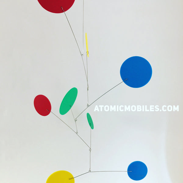 Exuberant hanging art mobile in delightful colors by AtomicMobiles.com