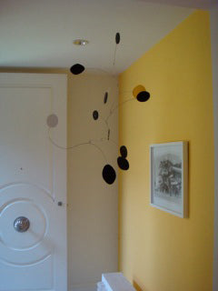Black kinetic art mobile hanging in Beverly Hills home by AtomicMobiles.com