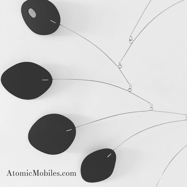 Elegant all black MCM art mobile by AtomicMobiles.com