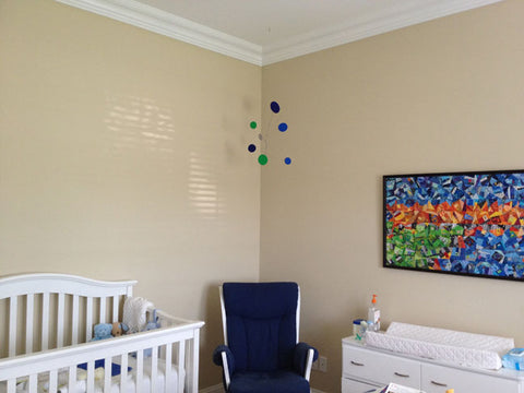 Client Photo of Atomic Mobile hanging in baby nursery