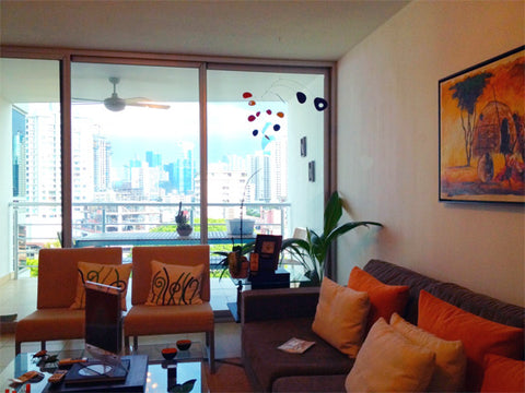 Hanging art mobile in living room in Panama - mobile by AtomicMobiles.com - image by client