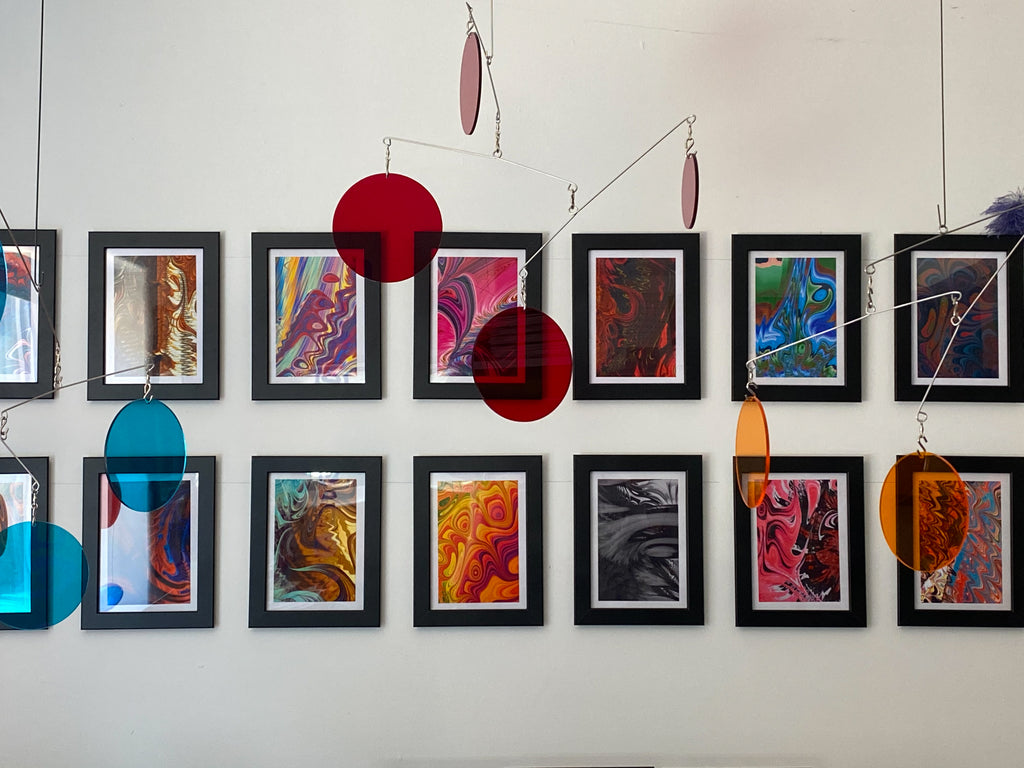 Wall of MiniMOD colorful abstract framed art prints with clear acrylic Atomic Mobiles by AtomicMobiles.com