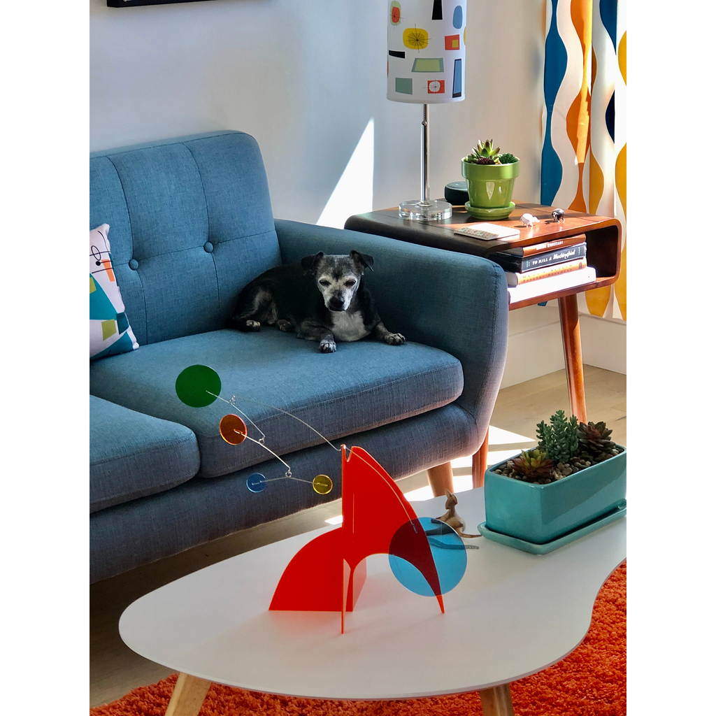 Cute dog in mid century modern living room looking at modern kinetic art stabile sculpture by AtomicMobiles.com
