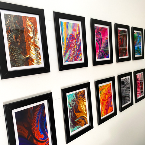 Multiple Atomic Art Prints displayed on wall - bold colorful abstract modern art by AtomicMobiles.com
