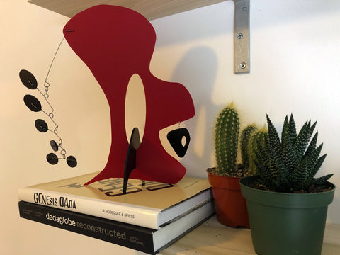 Modern art stabile by AtomicMobiles.com with books and succulent and cactus plants