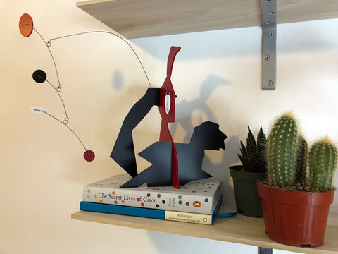 Modern art stabile by AtomicMobles.com with books and succulent and cactus plants