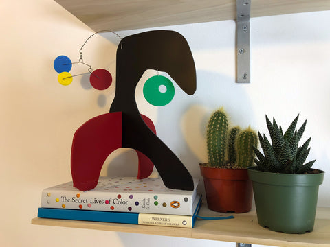 Modern art stabile sculpture with books and succulent and cactus plants by AtomicMobiles.com