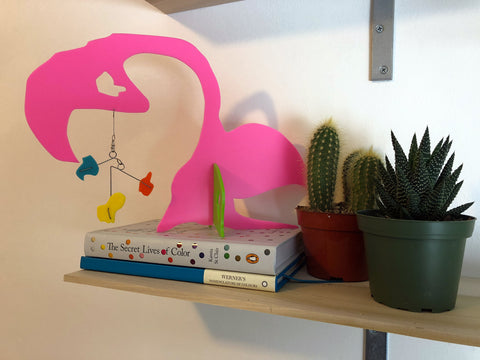 Flamingo modern art stabile with books and cactus and succulent plants by AtomicMobiles.com