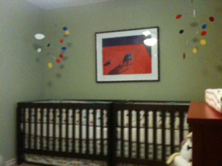 Two hanging mobiles by AtomicMobiles.com in twin baby nursery - photo by client