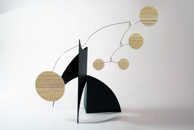 The Moderne Stabile with black base and bamboo circle shapes by AtomicMobiles.com