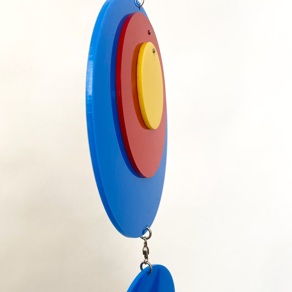 Side view of Groovy Twirly Blue Multi Color Vertical Kinetic Mobile in Blue Red and Yellow by AtomicMobiles.com
