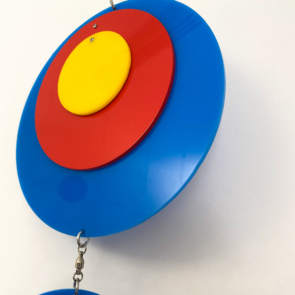 Beautiful Groovy Twirly Blue Multi Color Vertical Kinetic Mobile in Blue Red and Yellow by AtomicMobiles.com