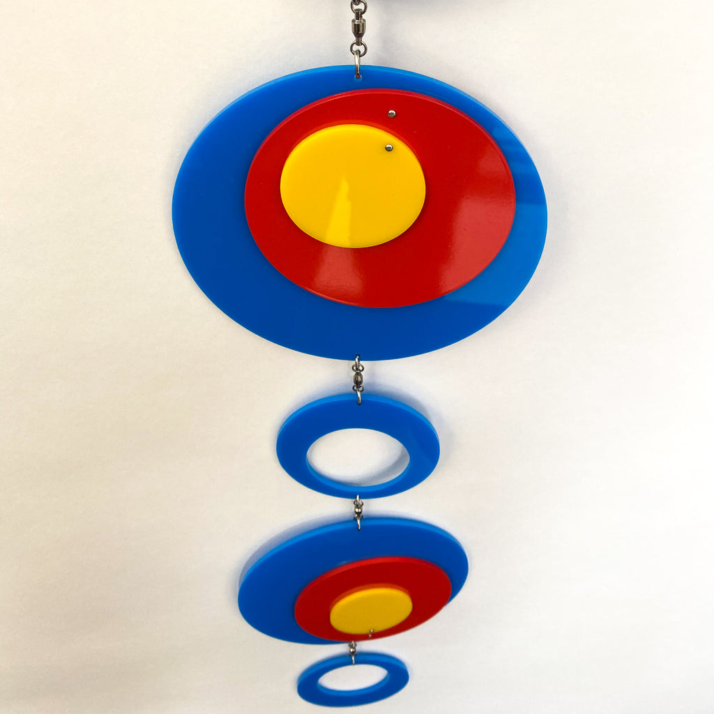 Another view of Groovy Twirly Blue Multi Color Vertical Kinetic Mobile in Blue Red and Yellow by AtomicMobiles.com