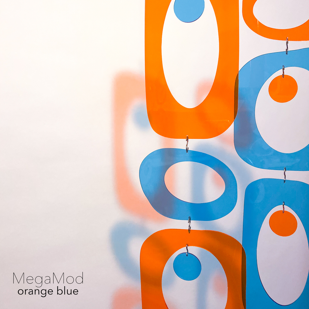 Pretty orange and blue DIY Atomic Kits in clear color plexiglass acrylic that casts beautiful shadows - mid century modern style hanging art mobiles, curtains, room dividers, screens by AtomicMobiles.com
