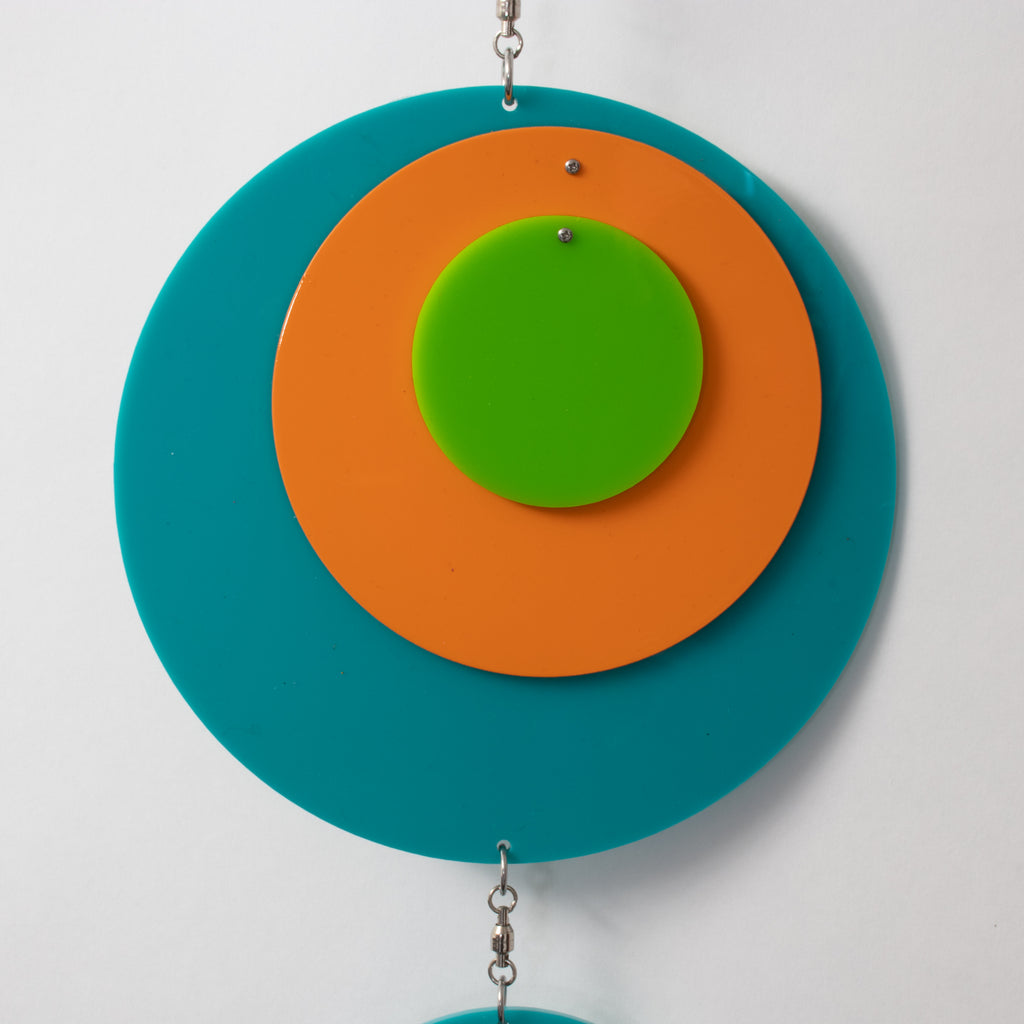 Closeup of beautiful Palm Springs Wall Art Mobile in Aqua Blue, Orange, and Lime Green by AtomicMobiles.com