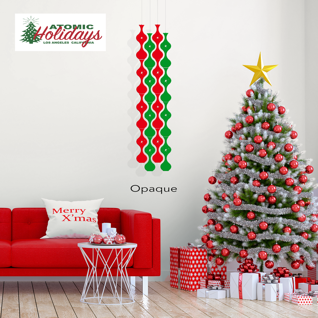 Jeannie Stardust Christmas Mobiles in transparent red and green acrylic - Mid Century modern Holiday decorations with beautiful Christmas tree and red sofa in modern roomby AtomicMobiles.com