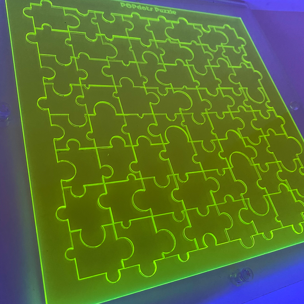 Lime Green Fluorescent Glo Jigsaw Puzzle under black light- Limited Edition Art Piece by AtomicMobiles.com