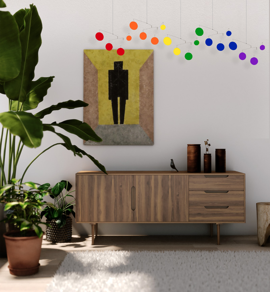 The Atomic Mobile in mid century modern room with credenza, shag rug, plants, and modern art print - Exclusive Rainbow Pride LGBTQ+ Colors by AtomicMobiles.com - Love is Love