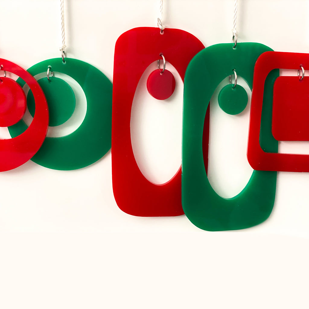 Closeup of mid century modern style Christmas Ornaments in red and green by AtomicMobiles.com
