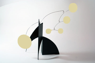 Desktop art stabile with glow-in-the-dark circle shapes and black base