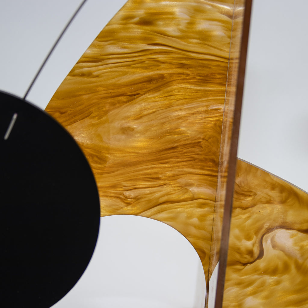 Moderne Exotics Stabile - beautiful marbled gold closeup with black circle - table top mobiles by AtomicMobiles.com