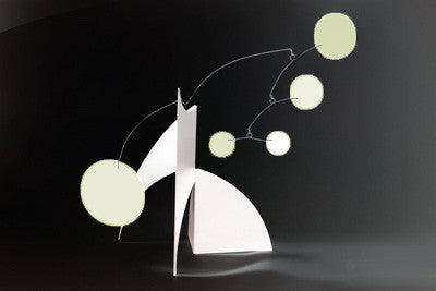 Desktop art stabile with glow-in-the-dark circle shapes and white base