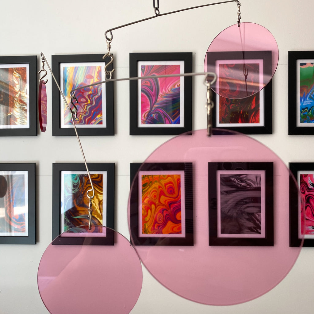 Clear Pink Acrylic Atomic Mobiles in front of MiniMOD abstract colorful art prints by AtomicMobiles.com