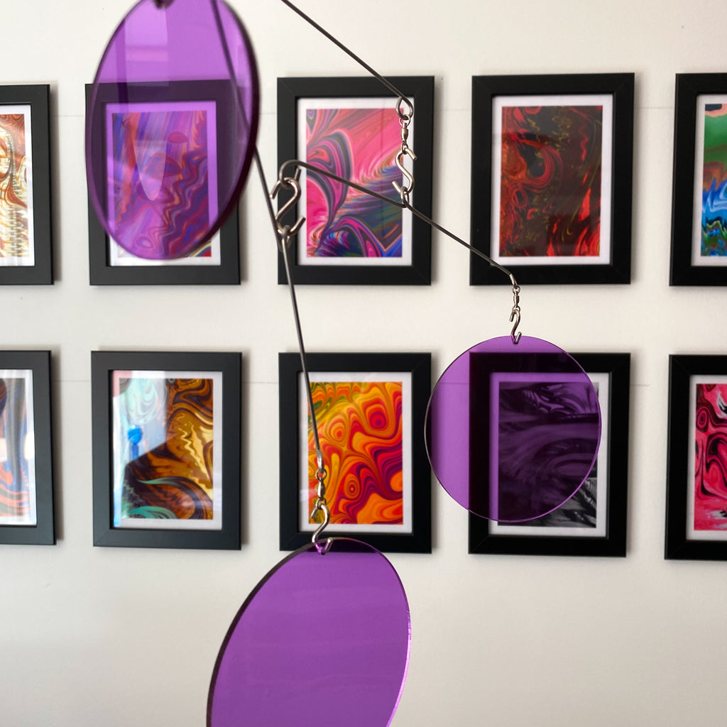 Clear Purple Acrylic Atomic Mobiles in front of MiniMOD abstract colorful art prints by AtomicMobiles.com