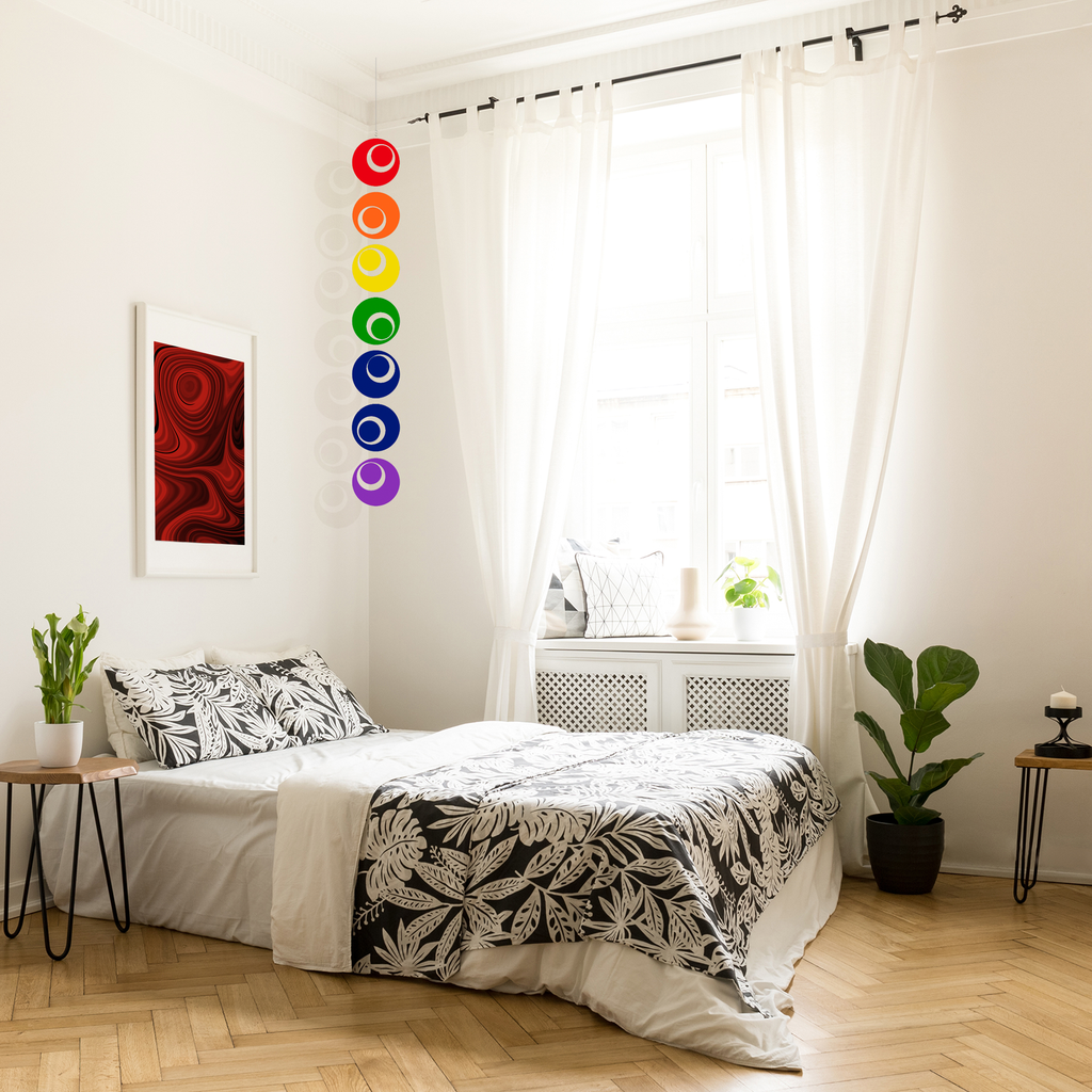 Cozy bedroom with rainbow Groovy hanging art mobile by AtomicMobiles.com