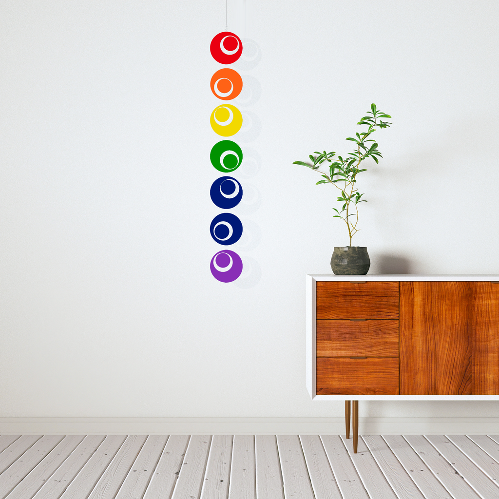 Modern credenza with plant and Rainbow Hanging Art Mobile by AtomicMobiles.com