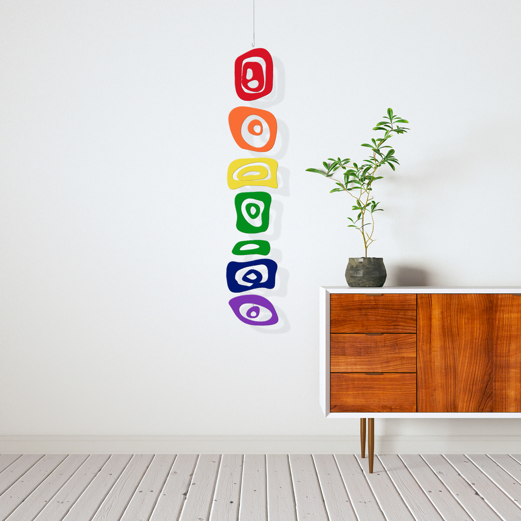 LGBTQ Rainbow Hanging Art Mobile next to mid century modern credenza with zen plant by AtomicMobiles.com