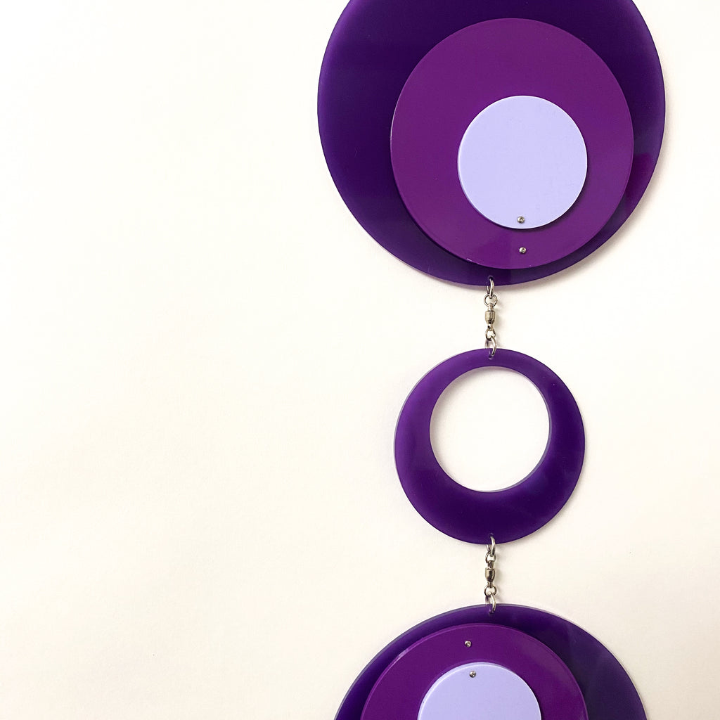 Closeup of Retro 1970s vertical kinetic art mobile in purple circle DOTS ready to ship today by AtomicMobiles.com