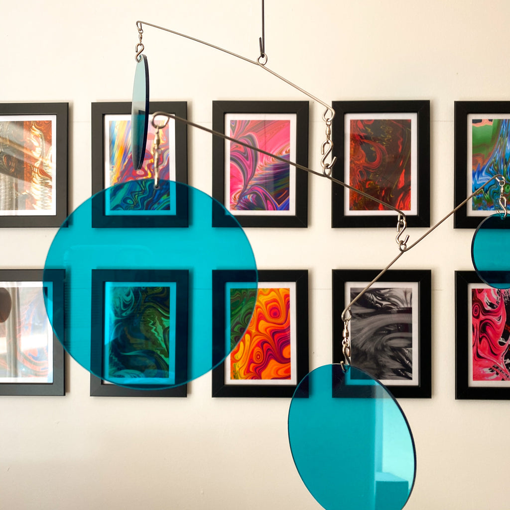 Clear Teal Acrylic Atomic Mobiles in front of MiniMOD abstract colorful art prints by AtomicMobiles.com