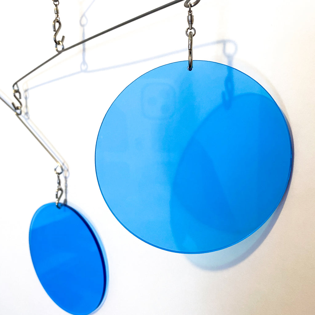 Closeup of Clear Blue Acrylic Atomic Mobile - kinetic hanging art mobiles for modern home decor by AtomicMobiles.com