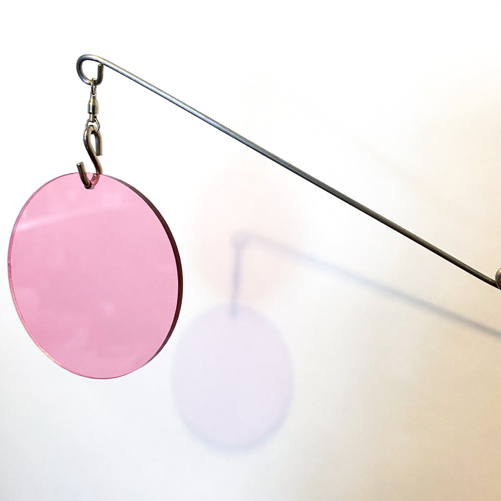 Closeup of Clear Pink Acrylic Atomic Mobile - kinetic hanging art mobiles for modern home decor by AtomicMobiles.com