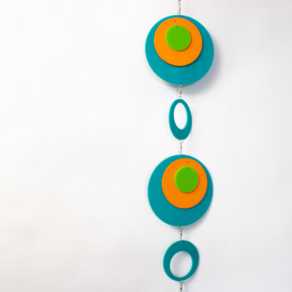 View of beautiful Palm Springs Wall Art Mobile in Aqua Blue, Orange, and Lime Green by AtomicMobiles.com